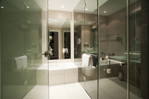 Modern bathroom with lots of glass and white tiles